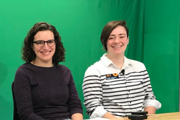 TPS Fellow Katie D'Amico and a COSI educator prepare to present in front of a green screen