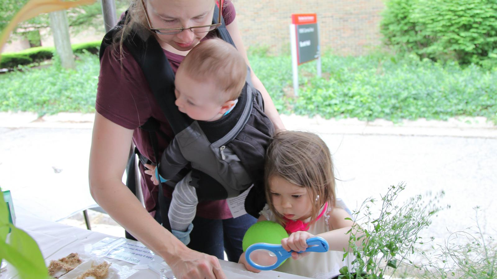A family explore plants at WestFest 2018